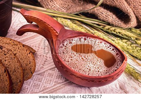 Bowl of kvass. Fermented russian traditional beverage.