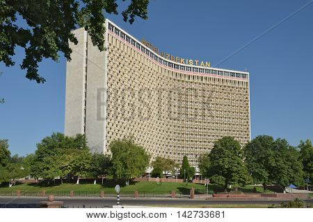 "Tashkent, Uzbekistan - July 2, 2014: Hotel ""Uzbekistan"" (1974) is a legendary hotel that takes guests for several decades and is considered to be one of the symbols of Tashkent city. Multi-storey hotel building built in book"