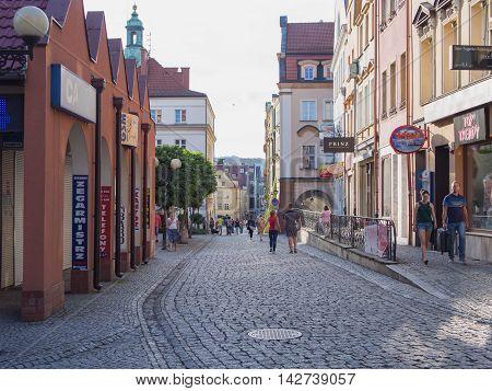 JELENIA GORA POLAND - AUGUST 13 2016: Tourists Walking Through Historic Downtown in Jelenia Gora Poland