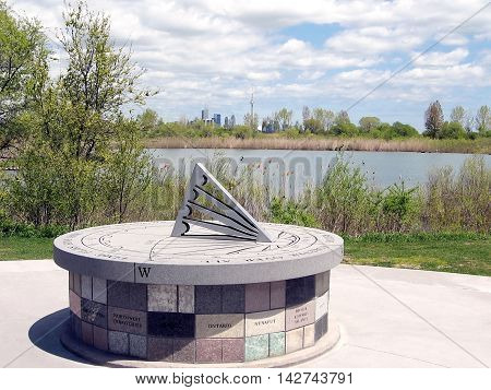 Sun-dial in Air India memorial in Humber Bay Park on bank of lake Ontario in Toronto Canada