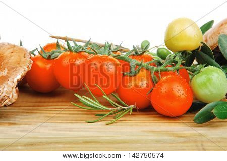 fresh raw vegetables served on wooden board