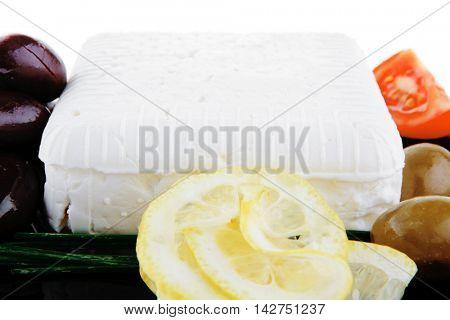 image of soft feta cheese on black