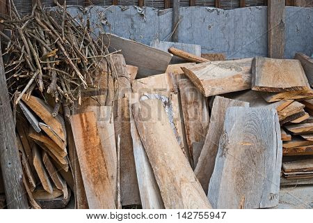 old planks and branches in a wooden wall. background