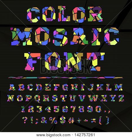Colored font from the broken into fragments letters. Broken alphabet on a dark background. Broken letters. Decorative alphabet. Stencil type. Full set