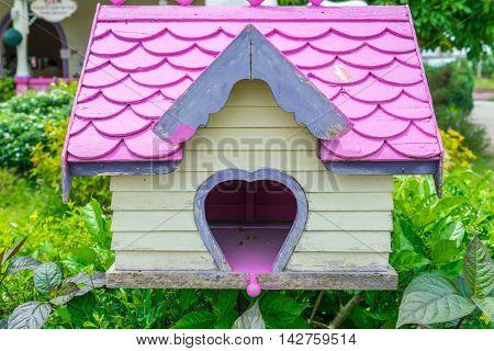 Wooden bird house in park