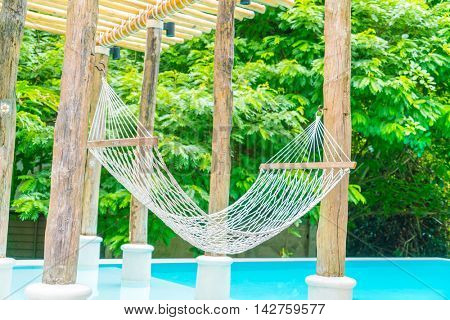 White hammocks in Luxury swimming pool