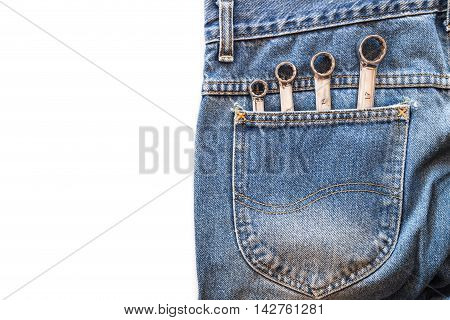chrome lug spanner in back blue jeans pocket on white isolated background. Copy space for text poster