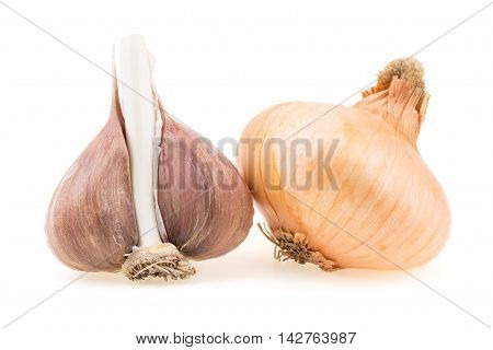 Onion and garlic isolated on white background. Selective focus.