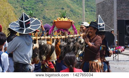 Cuicocha, Imbabura / Ecuador - June 22 2014: Indigenous group celebrating the solstice party near Cuicocha lagoon