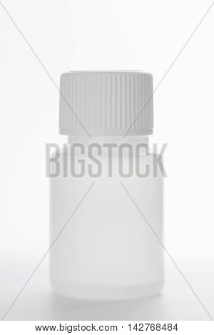 White Plastic Medical Container Bottle, On Gray Background