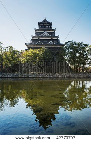 Hiroshima Castle with reflection in Hiroshima Japan