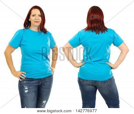 Photo of a woman posing with a blank light blue t-shirt and red hair ready for your artwork or design.