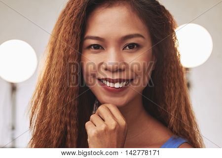Face of Filipino young woman smiling and looking at camera