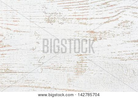 Old wooden board with peeling paint.  Grunge background.
