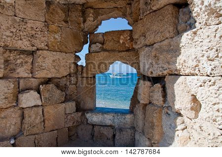 Medieval loophole in the old town on an island Rhodes Greece.