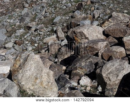 Big gray stones. Grey stones and rocks texture background. Stone surface. Abstract background textured of many granite rough stones. Filled frame picture.