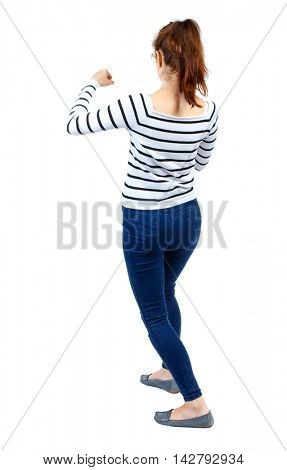 back view of woman funny fights waving his arms and legs. Rear view people collection. backside view of person.  Isolated over white background. Girl in a striped sweater fights with fists.