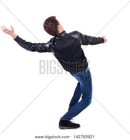 Balancing young man.  or dodge the falling man. Rear view people collection.  backside view of person.  Isolated over white background. Curly guy in a black leather jacket falls on his back.