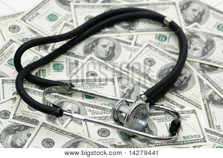 Medical concept -  stethoscope over the dollar bills
