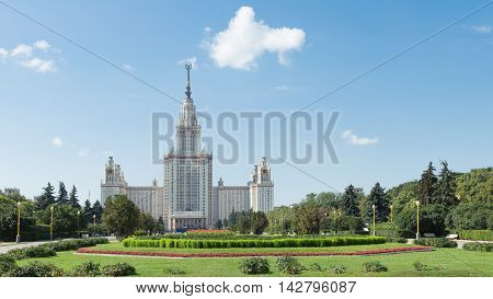 Moscow - August 11 2016: Beautiful Moscow State University named after Lomonosov on the Sparrow Hills and beautiful red flowers in the foreground August 11 2016 Moscow Russia