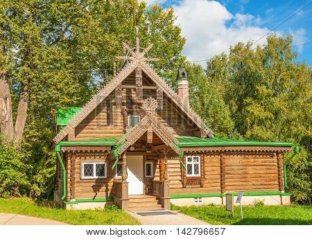 Fabulous log cabin decorated with wood carvings-striking example of pseudo-Russian style characteristic for second half of XIX century in homestead museum Abramtsevo. Russia, Moscow region, Abramtsevo. September 6, 2014