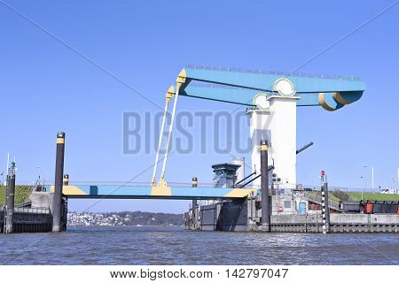 Closed drawbridge and blue sky. Elbe river.