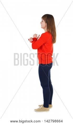 back view of standing young beautiful  woman.  girl  watching. Rear view people collection.  backside view of person.  The girl in the red sweater is left side