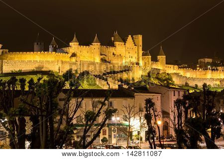 CARCASSONNE FRANCE - MAY 04 2015: Medieval castle and city of Carcassonne at night Languedoc-Roussillon France
