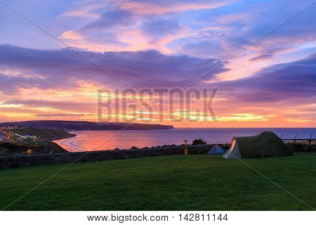 WHITBY ENGLAND - AUGUST 12: Two tents on ground near Whitby Abbey overlooking sea. In Whitby North Yorkshire England. On 12th August 2016