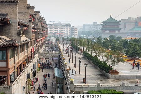 Xian China - October 17 2013: View of the square near the Bell Tower in Xian obscured in the smog Shaanxi Province China.