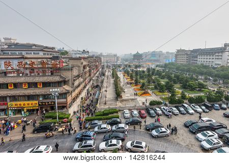 Xian China - October 17 2013: View of the square near the Bell Tower in Xian Shaanxi Province China.