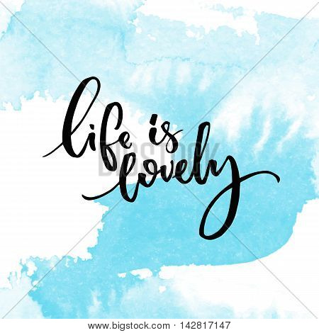 Life is lovely. Inspiration quote handwritten on blue watercolor swash texture.