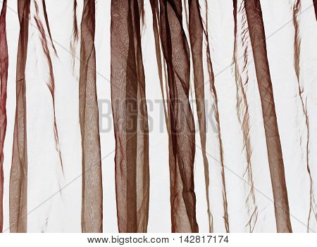 Voile crumbled folded curtain background in brown colours