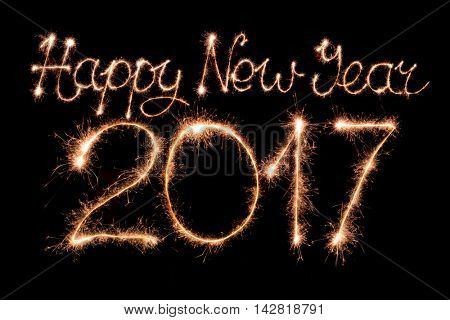 Happy new year 2017 text made from sparklers firework light