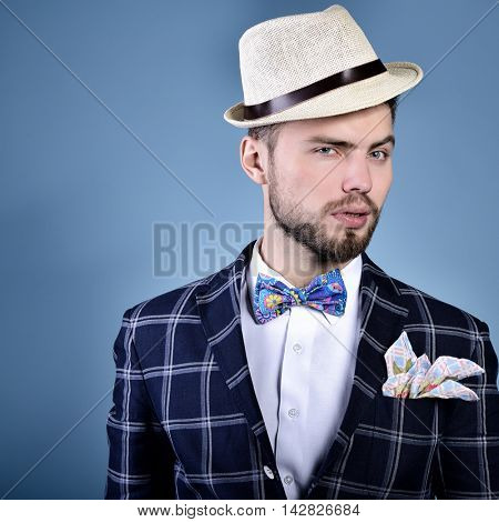 Compere. Man master of ceremonies in hat over blue background