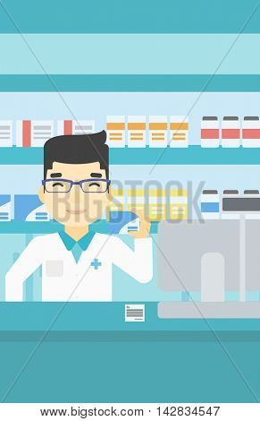 An asian young pharmacist standing at the counter and showing some medicine. Male pharmacist holding a box of pills in the pharmacy. Vector flat design illustration. Vertical layout.