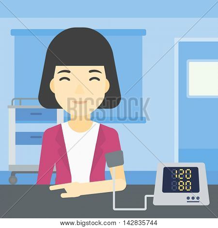 Asian woman checking blood pressure with digital blood pressure meter. Woman taking care of her health and measuring blood pressure in hospital room. Vector flat design illustration. Square layout.
