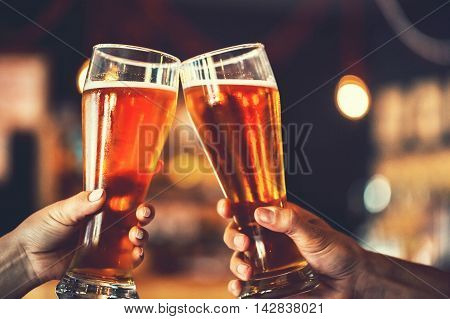 Two Friends Toasting With Glasses Of Light Beer At The Pub. Beautiful Background Of The Oktoberfest.