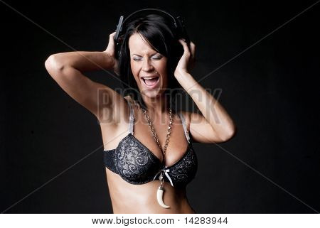 Sexy lady in lingerie with headphones