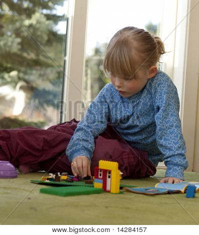 Child building a house