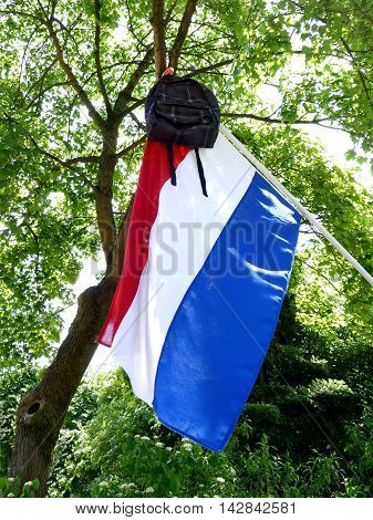 Dutch tradition to hang schoolbag on flague pole when graduating