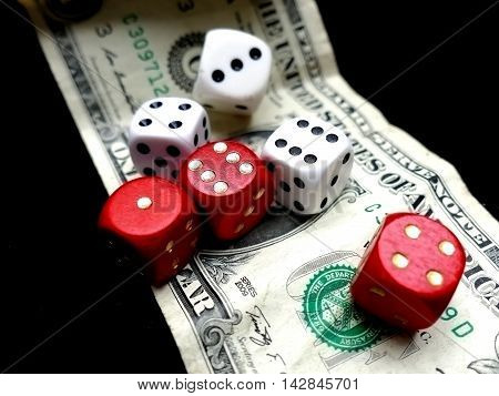 Dice on one dollar bill. Gambling concept
