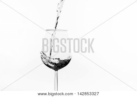 a liquid like water or wine i splashing into a wine glass - an abstract background in black and white