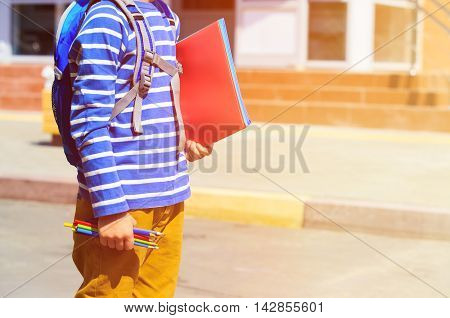 little boy goes to school or daycare, back to school
