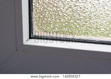 Moisture and mold in window by poor ventilation