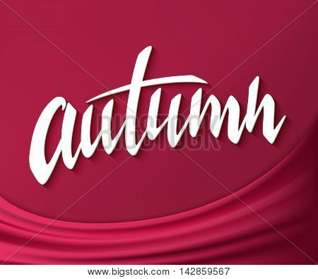 vector hand drawn autumn lettering label on silk fabric background.