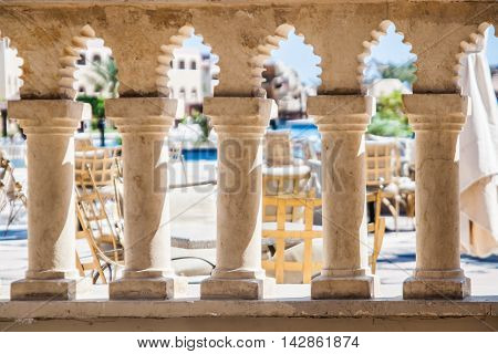 through the columns visible in the Arabic style restaurant tables. Hotel Sentido. Hurghada. Egypt. September 2011.