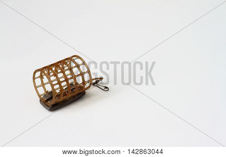 Cage feeder used in coarse and carp fishing isolated on a white background