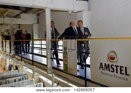 ST. PETERSBURG, RUSSIA - AUGUST 11, 2016: Vice-governor of St. Petersburg Igor Divinsky during his working visit to the Heineken brewery. The brewery can produce over 5 millions HL of beer per year