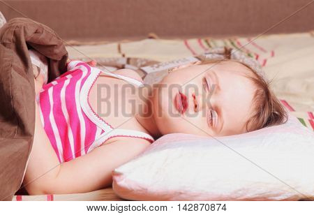 Baby girl relaxing in bed. Sleeping time.